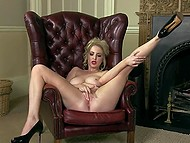 Big-tittied female often polishes wet vagina in leather armchair by the fireplace 9