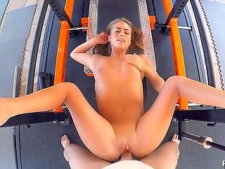 Coach admires young sportsgirl's strong booty and fucks her on a gym device