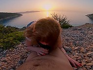 Beautiful sea view can be seen behind red-haired girl's back while she sucks husband's thing 5