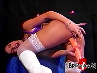Huge dildo and some vibrating toys are at disposal of brunette MILF in vintage sextape 8