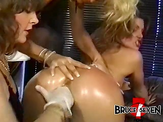 Three crazy ladies get turned on and set strapon in motion in retro porn video