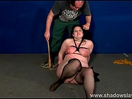 Mature dominant ties up chubby brunette slave, spanks her with whip and tramples with boots 4