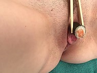 Young perverted girl from Japan rubs sushi against shaved pussy to make them yummy