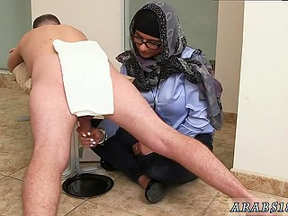Arab girl in headscarf presents handjob now to black man now to white comrade