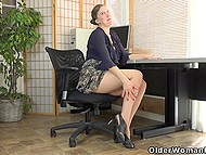 British secretary gets tired of office paperwork and teases unshaven pussy to cheer herself up 4