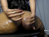 Arousing Indian female lubes her giant buttocks and shoves sex toy in anal hole 7