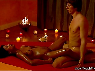 Relaxed Indian girl lies on red blanket and guy gently masturbates her pussy with fingers