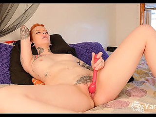 Ginger babe with small boobies and tattoos all over her body shoves vibrator in pussy