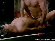 Stately man couldn't find a better place than billiard table for sex with pretty lady in retro video