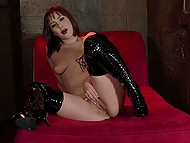 Sultry Latina Jenny Sativa in lacquer over-the-knee boots satisfies herself on red couch 11