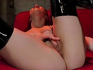 Sultry Latina Jenny Sativa in lacquer over-the-knee boots satisfies herself on red couch 7