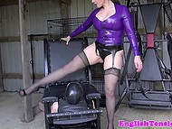 Black-haired mistress in stockings puts her giant buttocks on face of masked slave 9