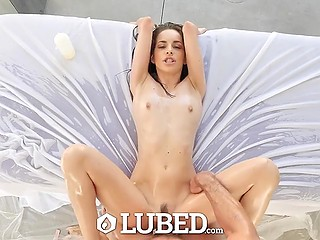 Skinny lass spares no oil pouring it all over her body thus making cock enter inside as seamless as possible