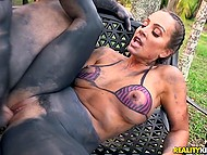 Tanned MILF with painted jeans and bikini finds man who was in mood for outdoor quickie 6