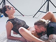 Comely model and inked photographer interrupted photo shoot to have sensual anal sex