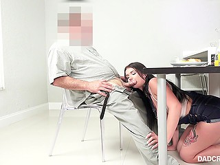 Brunette is not allowed to leave the house and she sucks stepdad's cock under table hoping that he will release her
