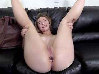 After short interview, porn agent inserts anal plug into asshole of amateur chick and she is happy