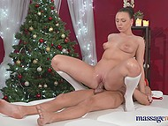 Attractive masseuse in Christmas outfit Morgan Rodriguez uses all ways to make client cum