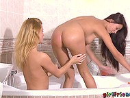 Comely girlfriends relax together in bathroom and blonde gently shaves partner's cleavage 7