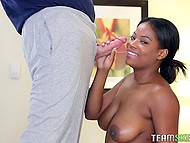 Ebony sweet thing smears juicy breasts and butt with oil then takes white cock in mouth