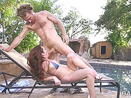 Couple of young lovers has passionate sex right by the summer pool on deck chair 8