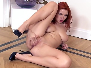 Sexy ginger looker bares her wonderful natural boobies and puts fingers inside pussy