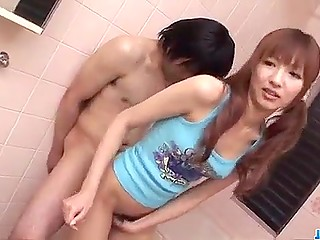 Skinny Japanese with ponytails bends forward a bit letting guy rub cock against her sissy from behind