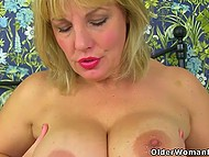 Mature British lady in stockings show off curvy shapes and set some adult toys in motion 4