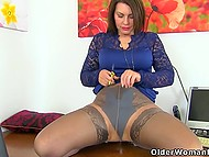 Mature British lady in stockings show off curvy shapes and set some adult toys in motion 9