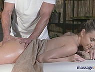 Young doll with nice tattoo on the hand enjoys the most gentle oil massage with cunnilingus 9