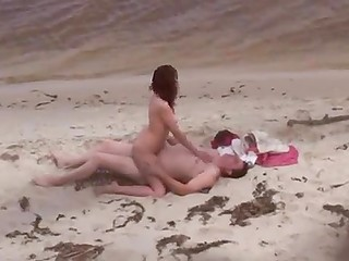 Attentive voyeur manages to record some sinful couples doing dirty things on seashore