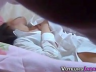 Voyeur hides under a blanket to record masturbating session of lonely Japanese MILF 8