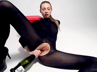 Girl in black outfit doesn't throw away empty champagne bottle hoping to receive anal pleasure from it