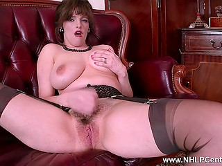 Noble lady in sexy stockings and with huge bosoms removes her skirt to play with sensitive clitoris