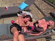 Two seasoned MILFs in exciting nylon stockings have hot lesbian fun on sun lounger