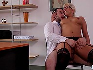 Buxom blonde secretary in sexy stockings and with amazing tattoos gives herself to boss right on table