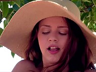 Weather is hot and young cutie in big hat sits in the shade of the tree and masturbates pussy 10