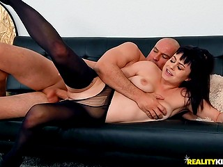Bald stallion Sean Lawless tears pantyhose of brunette totty and drills tight pussy with big dick
