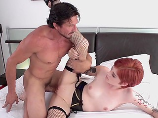 Short-haired redhead gladdens bearded man and puts on sexy outfit before he drills girl's pussy