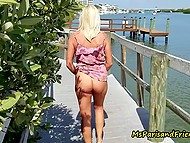 Blonde mature woman walks around the city flashing her private body parts then takes off dress