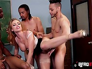 Busty history teacher Britney Amber with red hair masturbates on the table and black students treat her with big cocks 7