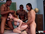 Busty history teacher Britney Amber with red hair masturbates on the table and black students treat her with big cocks