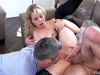 Bearded man with tattooed hand fucks blonde girl who lavishly squirts on her husband's face