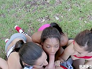 Outdoor physical activities are over and happy girls kneel to suck coach's cock on camera