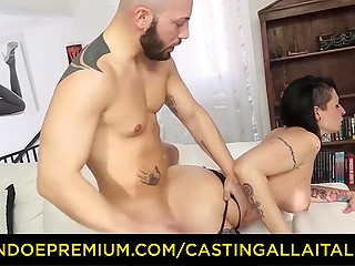 Bald man with beard and staggering Italian brunette show how they make love on camera