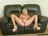 Amateur woman takes off all clothes willing to rub wet pussy while lying on couch 9