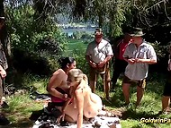 Mature blonde and sexy BBW brunette take part in outdoor group fun with strange men 4