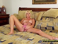 Blonde mature woman with pierced nipples starts the weekend with masturbation on the bed 4