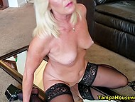 Mature blonde in stockings won't go to work until plays with fingers and dildo that is attached to the mirror 8