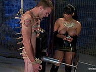 Dominant Latina Isis Love attaches clothespins to slave's body and fucking machine will make him ejaculate